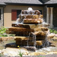 Stacked granite slabs with fountain/waterfall in the center