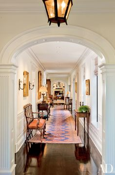 The public rooms open off a long gallery in this Santa Barbara, California, home by Appleton Partners LLP-Architects. Read on for more hallways decorated by AD100 honorees.