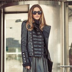 Snapped at London Fashion Week: Westward Leaning sunglasses, Boda leather jacket, Reiss skirt, Christian Louboutin heels, and a Whistles clutch.