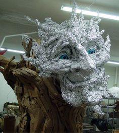 SuperForest: Kim Graham's Giant Paper Eco-Troll.  http://superforestnyc.blogspot.com/2008/12/kim-grahams-giant-paper-eco-troll.html