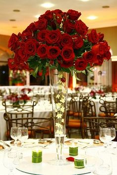 Red roses with little white flowers hanging down in middle