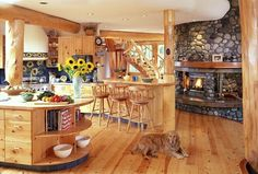 log home interior, love the mammoth sunflowers, they brighten up the space. Can't wait to finish our remodel and keep beautiful flowers around like this :-)