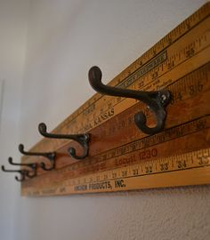 Coat rack made out of old rulers or maybe hockey sticks?! How fun would that be in a boys room!?