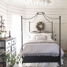 beautiful iron bed with dreamy linens