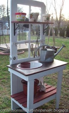 Old door potting bench, this would be awesome with a repurposed sink like that for rinsing plants and I love the fact that its a windowed door so it doesn't have to block any views Old Door Projects, Garden Projects, Garden Ideas, Craft Projects, Repurposed Furniture, Diy Furniture, Repurposed Doors, Recycled Door, Repurposed Items