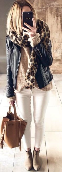 woman wearing leather jacket, sweater, and fitted jeans holding bag and smartphone. Pic by White Bootcut Jeans, Jeans Fit, White Jeans, Grey Fur Coat, Wool Coat, Cozy Winter Outfits, Spring Outfits, Long Sleeve Tops, Autumn Fashion