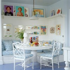 A Jeff Koons vase in the kitchen with chairs by Artistic Frame and portraits by Neil Winkour and childrens paintings