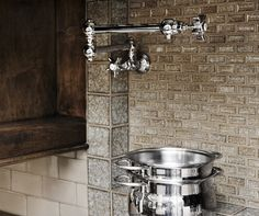 The beautiful backsplash tile, made of crushed glass using centuries-old technique, is paired with an English pot-filler by Perrin & Rowe.