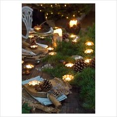 natural rustic christmas decorations   GAP Interiors - Decorated table and candles at Christmas - Picture ...