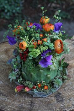 purple and orange arrangement in artichkoe; hops at base, Françoise Weeks