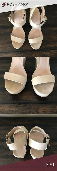 Nude Wedges High wedges that are super comfortable. I've worn these a handful of times, and there is some scuffing that is noted in the pictures. The buckle on the side is gold. Heel height is ~5 inches. Shoes Wedges