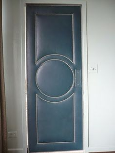 An upholstered leather swinging door!  Add it to my list of swinging door ideas - similar to another I recently added.