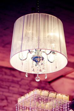 Gorgeous chandelier with sheer lamp shade. Photo by Joel Jordan Photography. #wedding #lighting
