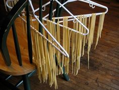 How To Dry Pasta Without a Rack--because why buy a rack when you already have hangers and chairs(or, I suppose anything else you can hang a hanger on).