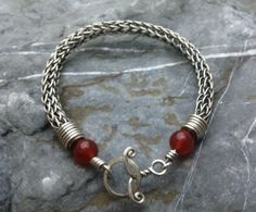 Sterling silver viking wire weave with carnelian beads, made by Mark Harris at Silver Crescent