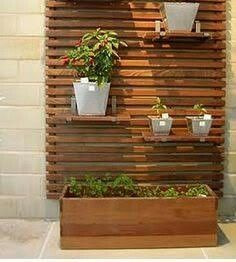 Wall planter.. Down the front porch but with more plants and maybe just hanging instead of shelves.
