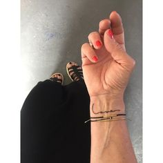 L O V E: Tiny wrist tattoo