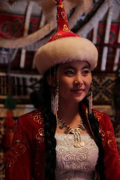 The traditional dresses of Kazakh women were stitched with a little distinction for the women belonging to various age groups. The Kazakh girls also used to wear two kinds of headdresses; skull cap (Takiya) and a warm hat (Borik), decorated with otter, fox or beaver fur. A tuft of owl feather was often sewed to the top of Takiya for further grace.