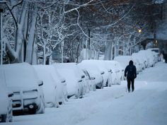 A fresh layer of snow covers Norwood Avenue in Buffalo, N.Y. on Friday, Jan. 9, 2015. Lake-effect snow and high winds are causing hazardous driving conditions across western New York.