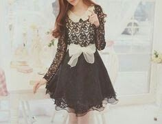 Beautiful black lace dress with a white bow and sailor collar.☺
