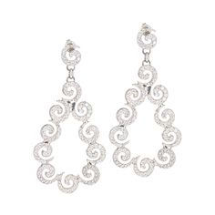 Dramatic crystal swirl design earrings.  These earrings are made with 14k white gold and Swarovski crystals