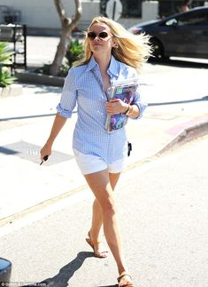 Happy lady:Wearing a light blue gingham shirt she opted for a bright ensemble teaming it with a pair of simple white shorts