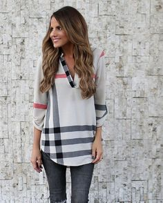 Cute print top with gray jeans.