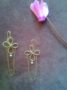 Gold flowers  earrings with a tiny fresh water pearl. $37.00, via Etsy.