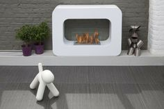 Orlando // White - The Orlando is a mod mobile fireplace that works on your living room floor or elevated for drama in your environment. The Orlando's bio-ethanol flame is dirt-free for a clean, contemporary look that changes up your decor. Bioethanol Fireplace, Modern Fireplace, Fireplaces, Freestanding Fireplace, Home Id, Home Tech, Living Room Flooring, Mid Century Modern Furniture, Cool Gadgets