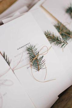minimalist wedding ceremony programs with evergreen branch