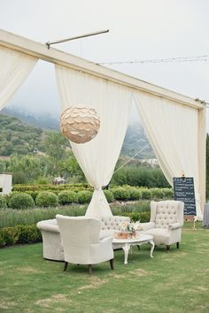 A lovely outdoor lounge in neutrals from Found Vintage Rentals shot by Onelove Photography