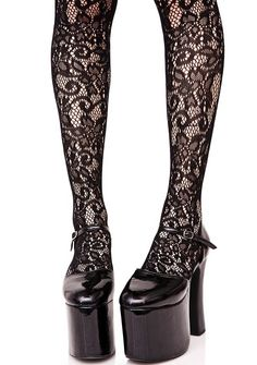 Garden Fairy Floral Pantyhose the flowers bloom just fer yew, bb. These pantyhose feature a stretchy black nylon construction with intricate flower details up yer leg to just above the knee.