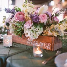 Beautiful flower box centerpieces with pastel flowers // Azelle Photography // Harvey Designs // http://www.theknot.com/weddings/album/a-rustic-romantic-wedding-in-savannah-ga-141165