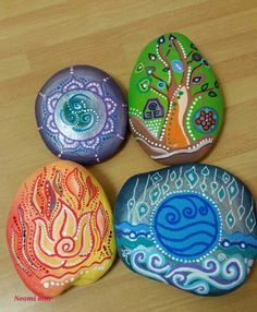 Four elements painted on rocks  by Neomi Mor