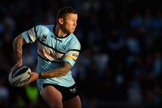 News Photo: Todd Carney of the Sharks passes during the…