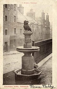 This is Greyfriars Bobby in Edinburgh, a famous dog that waited by his masters grave for years after his death.  * greyfriars bobby *  It still has the spout on it!