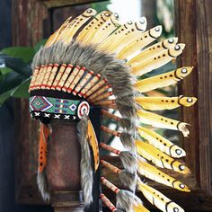 """Description:""""Cheasequah"""" - Translates as """"Red Bird"""" (Cherokee, Native American)Feathered war bonnets are worn by honored Plains Indian men. In the past they were sometimes worn into battle, but most often worn for ceremonial occasions as is the case today. They are seen as items of great spiritual and magical importance. Our headdress have been hand-made in respect to these traditions"""