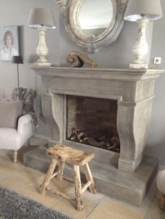 don't care for the snail looking thing or portrait on wall.or tiny black lamp thingy Fireplace Mantel Surrounds, Fireplace Mirror, Fireplace Design, Natural Stone Fireplaces, Modern Country Style, Country House Interior, Cozy Room, Living Room With Fireplace, Rustic Interiors