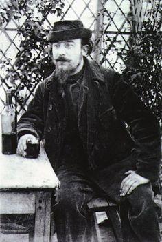 Erik Satie at a table in the park of the Moulin de la Galette.  Photograph by Santiago Rusiñol, 1892.
