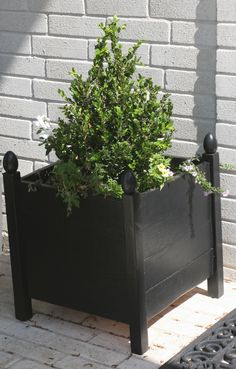Ana White | Build a Square Planters with Finials | Free and Easy DIY Project and Furniture Plans - these would be great by the front door and some that are long along the edges of my deck. She used wood eggs for the finials-smart!