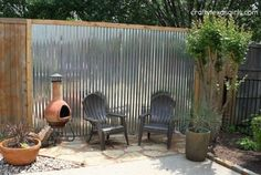 s 15 privacy fences that will turn your yard into a secluded oasis, curb appeal, fences, Make an outdoor accent wall from tin