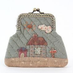 by Kato Reiko. I love how simple this little coin purse is.