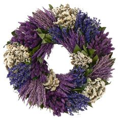Adorned with white sinuata and lavender, this lifelike wreath is a welcoming accent whether in the entryway or displayed above your mantel. Product: Preserved wreathConstruction Material: Silicone Color: Lavender and whiteFeatures: Includes grass, sinua Lavender Crafts, Lavender Wreath, Lavender Green, Wreaths For Front Door, Door Wreaths, Faux Flowers, Dried Flowers, Summer Wreath, 4th Of July Wreath