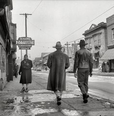 "February 1942. ""Detroit, Michigan. Back view of a Negro dressed in a zoot suit, walking in the business district"