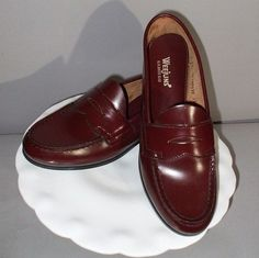 Everyone wore Bass Weejuns (penny loafers) in the mid sixties. You had to put a penny or a dime in the slot on top of the shoe.