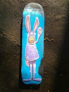 Bunny in a rabbit suit on skateboard By Brett Superstar