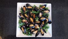 Mussels with Greens and Blue Cheese - This is a simple, yet elegant meal. Mussels are low in saturated fat while providing a great source of protein, minerals and In addition, mussels are a dietary antioxidant and a good source of vitamin C. Shellfish Recipes, Seafood Recipes, Pei Mussels Recipe, Blue Cheese Recipes, Cheese Ingredients, Food Articles, Smoked Bacon, Fish And Seafood, Serving Platters