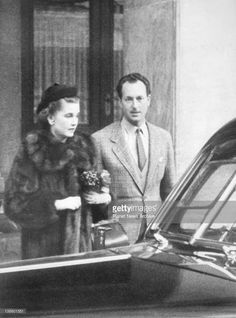 Princess Troubetskoi ( the former Barbara Hutton ) with her new husband, Russian Prince Igor Troubetskoi, as they left the Hotel Bernerhof Palace in Berne, Switzerland, during their honeymoon. The Princess, fabulously wealthy Woolworth heiress, recently ventured into matrimony for the fourth time when she married the Prince in Zurich.