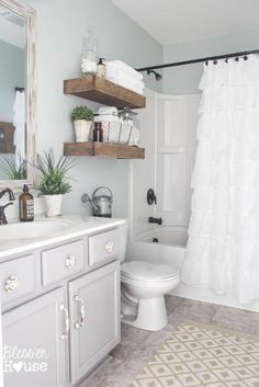 Modern Farmhouse Bathroom Makeover Reveal. Cabinet color:Benjamin Moore winter gateS semi gloss. Wall color: Sherwin williams sea salt