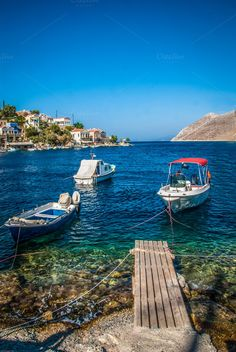 Check out Motor boats / Simy / Greek Island by ChristianThür Photography on Creative Market Boating Pictures, Motor Boats, Holiday Photos, Sun Lounger, Island, Creative, Greek, Places, Outdoor Decor